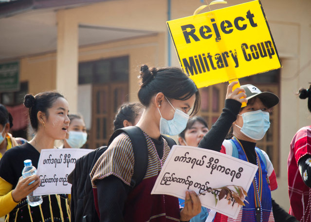 This handout from the Karen Information Center taken and released to AFP on March 31, 2021 shows ethnic Karen people taking part in an anti-military coup demonstration in Hlaingbwe township, in eastern Myanmar's Karen state. (Photo by Handout via AFP Photo)