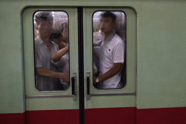 North Koreans travel on the Pyongyang metro on August 21, 2018 in Pyongyang, North Korea. (Photo by Carl Court/Getty Images)