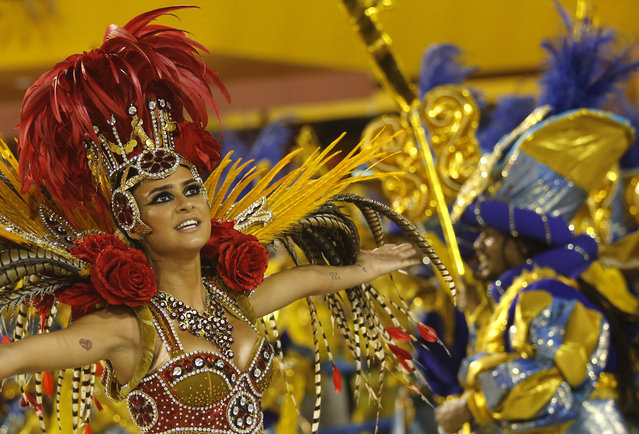 A performer from the Academicos do Grande Rio samba school dances during carnival celebrations at the Sambadrome in Rio de Janeiro, Brazil, early Monday, February 16, 2015. (Photo by Silvia Izquierdo/AP Photo)