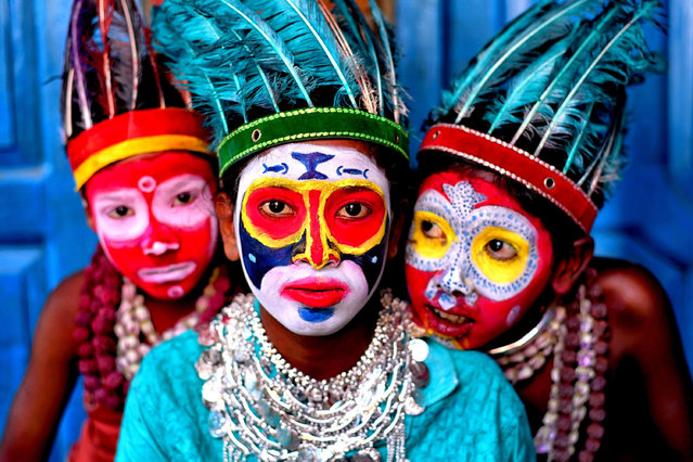 Children with painted faces in the art of the bahurupi tradition in Bardhaman, India on April 24, 2021. Impersonators family where their generations are engaged in making face painting and can easily metamorphose into different characters during a performance, as per different Traditional & Tribal myth which is the main earning source for their family. (Photo by  Avishek Das/SOPA Images/Rex Features/Shutterstock)
