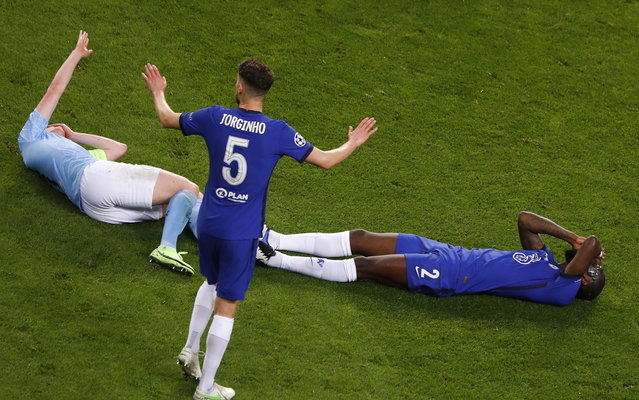 Kevin De Bruyne (L) of Manchester City and  Antonio Ruediger (R) of Chelsea react during the UEFA Champions League final between Manchester City and Chelsea FC in Porto, Portugal, 29 May 2021. (Photo by Susan Vera/EPA/EFE)