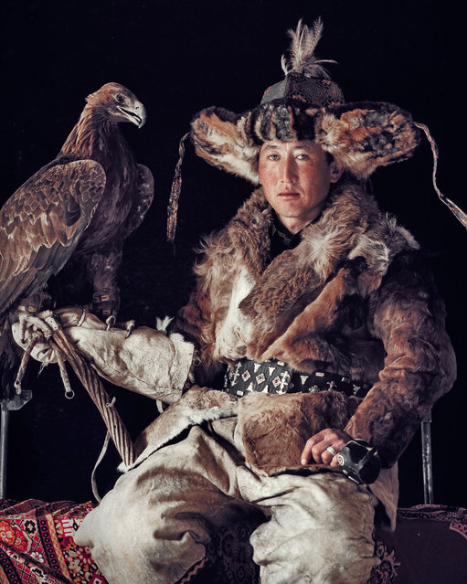The ancient art of eagle hunting is one of many traditions and skills that the Kazakhs have, in recent decades, been able to hold on to. They rely on their clan and herds, believing in pre-Islamic cults of the sky, the ancestors, fire and the supernatural forces of good and evil spirits. (Jimmy Nelson)