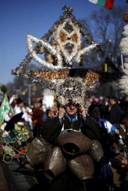 A participant dressed in traditional costume carries her mask during the International Festival of the Masquerade Games in the town of Pernik, Bulgaria January 30, 2016. (Photo by Stoyan Nenov/Reuters)