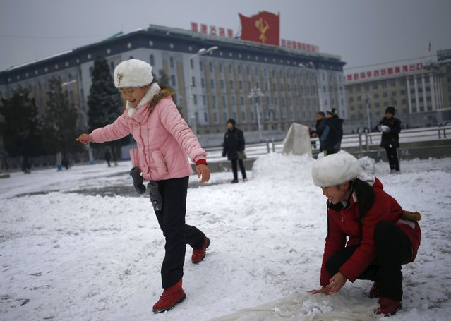 North Korean girls play with the snow on Kim Il Sung Square in Pyongyang, North Korea, where the winter season has started, on Sunday, December 16, 2018. (Photo by Dita Alangkara/AP Photo)