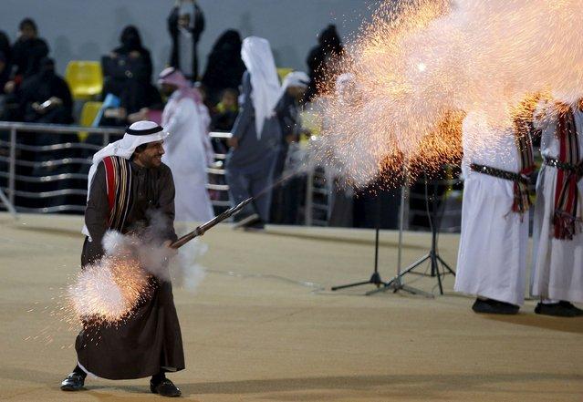 A Saudi man fires a weapon as he performs a traditional dance during Janadriyah Culture Festival on the outskirts of Riyadh, Saudi Arabia February 8, 2016. (Photo by Faisal Al Nasser/Reuters)