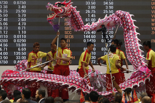 Filipinos perform a Dragon dance in front of the Philippine Stock Exchange electronic board in Makati's financial district, Manila, Philippines, 09 February 2016 as they celebrate the Chinese New Year. The Philippine economy grew at a 'respectable' 5.8 percent in 2015, a slower rate than the previous year and missing the government's annual target, an official said. Although still expected to be among the fastest in the region, gross domestic product (GDP) growth was slower than the administration's target of 7 percent to 8 percent, and down from 2014's expansion of 6.1 percent. Photo by Francis R. Malasig/EPA)