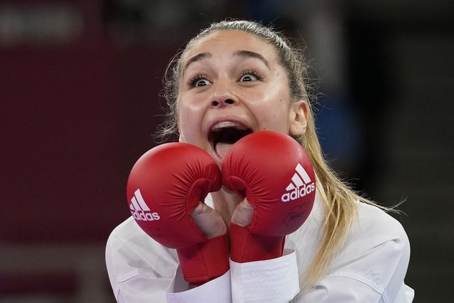 Anzhelika Terliuga of Ukraine, reacts after winning against Wen Tzu-yun of Taiwan in the women's kumite -55kg semifinal bout for Karate at the 2020 Summer Olympics, Thursday, August 5, 2021, in Tokyo, Japan. (Photo by Vincent Thian/AP Photo)