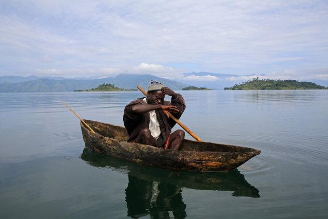 A fisherman works on Lake Kivu near Idjwi island in the Democratic Republic of Congo,  November 26, 2016. (Photo by Therese Di Campo/Reuters)