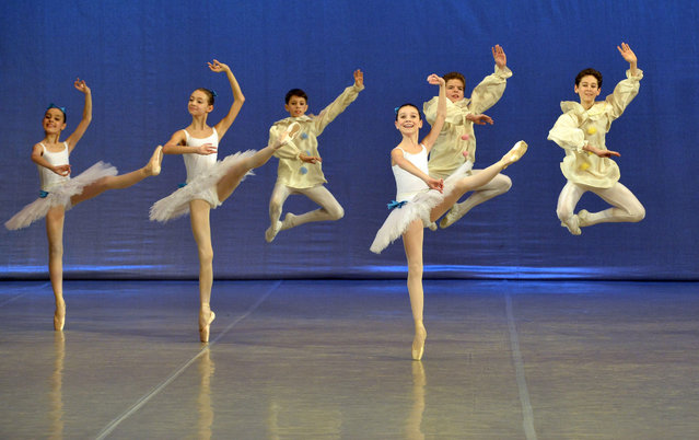 Students perform during a concert at the Moscow State Academy of Choreography, better known as the Bolshoi Ballet Academy, in Moscow, on March 3, 2016. (Photo by Yuri Kadobnov/AFP Photo)