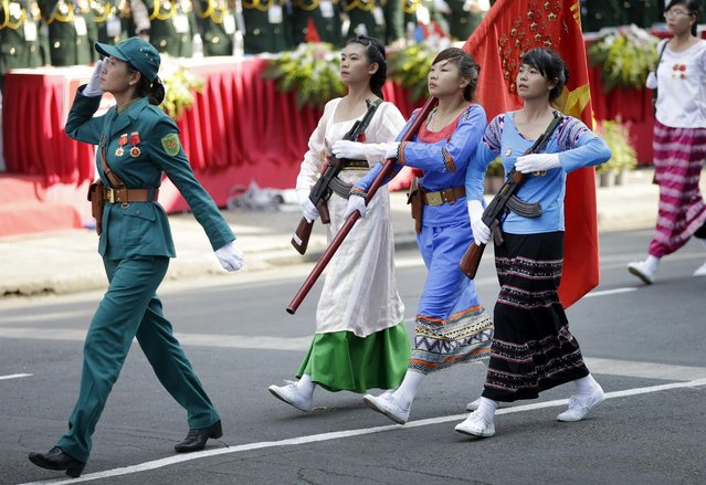Vietnamese military personnel in traditional dress take part in a parade celebrating the 40th anniversary of the end of the Vietnam War which is also remembered as the fall of Saigon, in Ho Chi Minh City, Vietnam, Thursday, April 30, 2015. (Photo by Dita Alangkara/AP Photo)