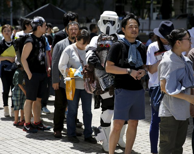 A cosplayer dressed up as Star Wars character Scout Trooper joins a line to attend a Star Wars Day fan event in Tokyo May 4, 2015. (Photo by Toru Hanai/Reuters)