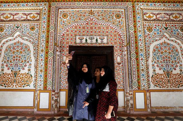 Students take selfies at the halls of historic Hindu temple as they visit Saidpur village, Islamabad, Pakistan on March 16, 2019. (Photo by Akhtar Soomro/Reuters)
