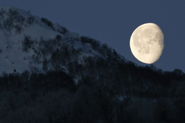 The moon is pictured above the mountains in Rosa Khutor during the 2014 Sochi Winter Olympics. (Photo by Arnd Wiegmann/Reuters)