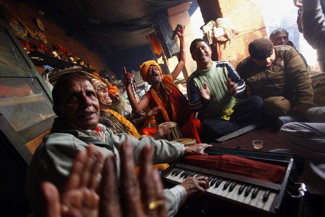 Hindu devotees sing religious songs in the courtyard of the Pashupatinath Temple in Katmandu, Nepal, Wednesday, February 26, 2014. Shivratri, a festival dedicated to the worship of Hindu God Shiva, will be celebrated Thursday. (Photo by Niranjan Shrestha/AP Photo)