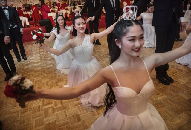 Chinese and foreign debutantes dance during the Vienna Ball at the Kempinski Hotel, March 19, 2016, in Beijing. (Photo by Kevin Frayer/Getty Images)