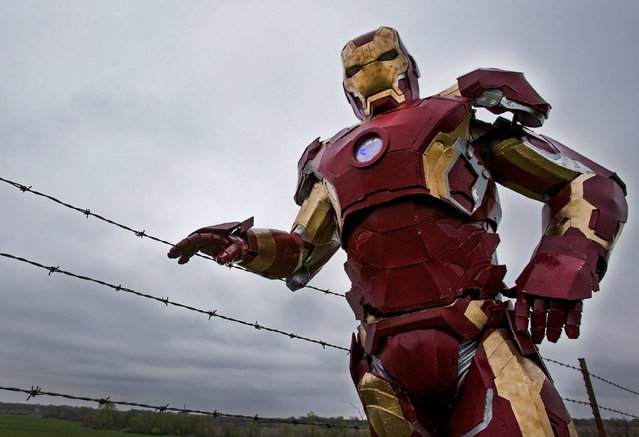 In this photo taken April 15, 2015, Clay Hielscher of Overbrook, Kan., poses for a photo in his home made Iron Man suit. While he enjoys building the battlesuits of his favorite super hero, Hielscher said the real reason he is so passionate about his pastime is his 11-year-old daughter, Kyrianna. They design and construct the suits together. (Photo by Chris Neal/AP Photo/The Topeka Capital-Journal)
