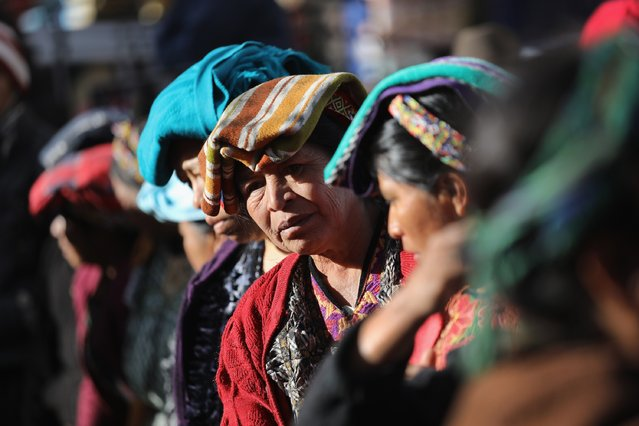 Women wait for shoppers at a vegetable market on February 11, 2017 in Almolonga, Guatemala. (Photo by John Moore/Getty Images)