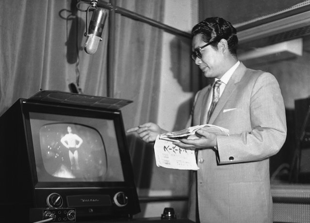 """Tooru Ohira, the Japanese voice of television's Superman, watches actor George Reeves closely while he dubs Japanese words for the show on July 7, 1959. Television has made a strong impression on the Japanese from Emperor Hirohito down. About 99 percent of Japanese TV shows are American, including the Emperor's favorite, """"Superman"""". (Photo by AP Photo via The Atlantic)"""