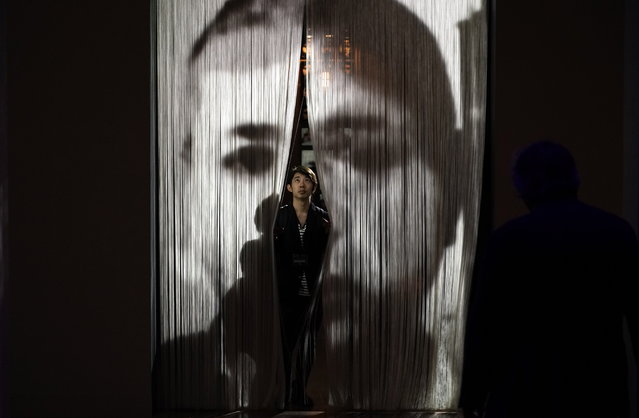 "A visitor walks through the artwork ""Entre-temps"" by French artist Christian Boltanski during the press preview of the ""Christian Boltanski – Lifetime"" exhibition at the National Art Center in Tokyo, Japan, 11 June 2019. The exhibition presents almost 50 artworks by the artist and will be open to the public from 12 June to 02 September 2019. (Photo by Franck Robichon/EPA/EFE)"