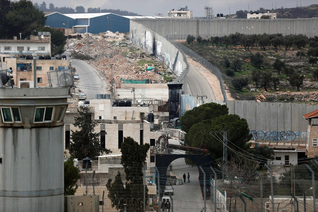 A picture taken from the window of one of the rooms at street artist Banksy's newly opened Walled Off hotel in the Israeli occupied West Bank town of Bethlehem, on March 3, 2017, shows Israel's controversial separation wall. (Photo by Thomas Coex/AFP Photo)