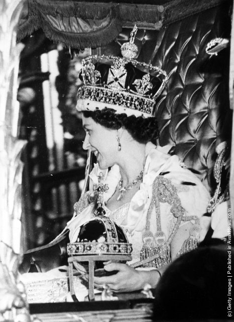 1953: Queen Elizabeth II wearing the State Crown and carrying the State orb in a Royal carriage after her Coronation ceremony