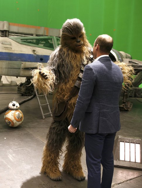 Britain's Prince William talks with Chewbacca during a tour of the Star Wars sets at Pinewood studios in Iver Heath, west of London, Britain, on April 19, 2016. (Photo by Adrian Dennis/Reuters)