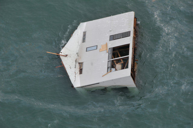 In this handout image provided by U.S. Air Force, a house is seen adrift off the coast of northeastern Japan from a HH-60G helicopter surveying the damage stricken area as part of Japan's earthquake and tsunami recovery effort March 14, 2011 in Japan. The quake struck offshore at 2:46 pm local time on March 11, triggering a tsunami wave of up to 10 metres which engulfed large parts of northeastern Japan. The death toll is still yet to be fully known, with fears that the numbers could run into the tens of thousands. (Photo by U.S. Air Force via Getty Images)