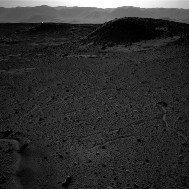A handout photo provided by NASA on 09 April 2014 shows an image from the Navigation Camera (Navcam) on NASA's Curiosity Mars rover including a bright spot near the upper left corner. The sun is in the same direction, west-northwest, above the frame. Bright spots appear in images from the rover nearly every week. (Photo by EPA/NASA/JPL-Caltech)