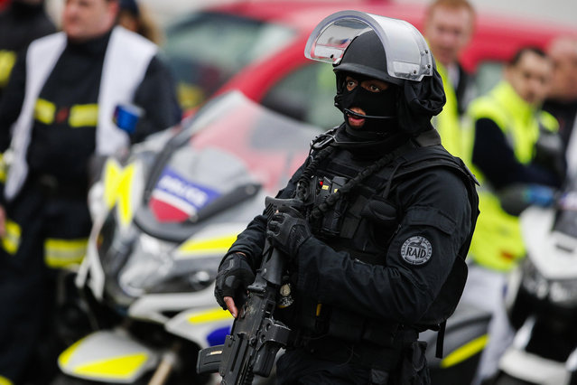 A member of the RAID, (Research, Assistance, Intervention and Deterrence), France's elite police force, patrols at Orly airport, south of Paris, Saturday, March, 18, 2017. Soldiers at Paris' busy Orly Aiport shot and killed a man who wrestled one of their colleagues to the ground and tried to steal her rifle Saturday, officials said. (Photo by Kamil Zihnioglu/AP Photo)