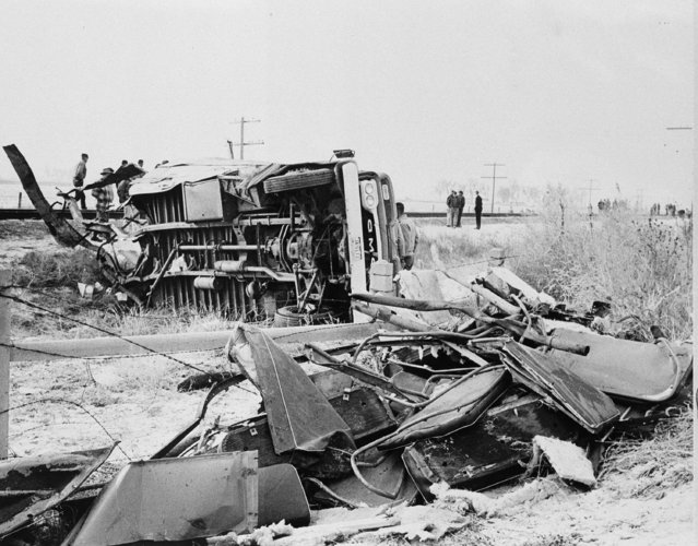 The shattered remains of a school bus that collided with a train in Greeley, Colorado, December 14, 1961. The overturned rear of the bus was the largest intact section. 20 children were killed in the accident. (Photo by AP Photo)