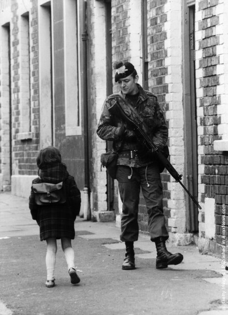 1981:  A Belfast girl chats to a soldier out patrolling the streets in the Falls Road area