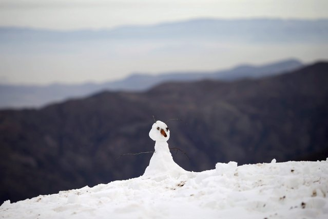 A snowman is seen at the El Colorado ski centre at Los Andes Mountain range, near Santiago, Chile, July 1, 2015. (Photo by Ueslei Marcelino/Reuters)