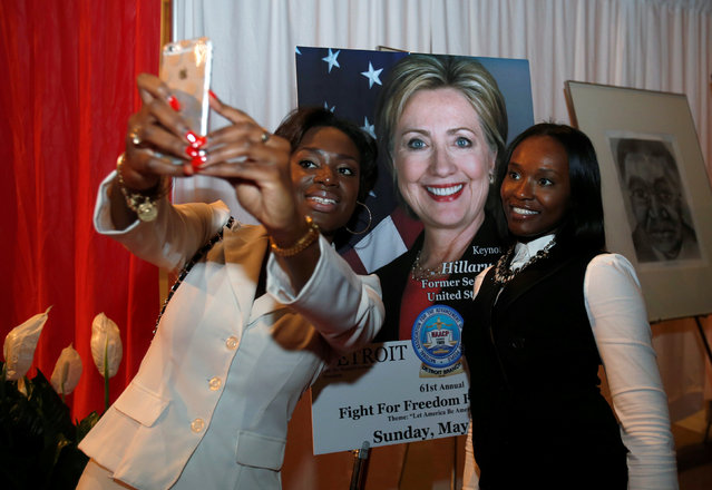 """Marcella Richardson (L) and Joi Cole take their photograph in front of a poster of Democratic presidential candidate Hillary Clinton before Clinton addresses the 61st Annual NAACP """"Fight For Freedom Fund Dinner"""" in Detroit, Michigan May 1, 2016. (Photo by Rebecca Cook/Reuters)"""