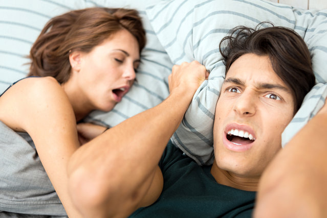Man cannot sleep because his wife snores. (Photo by ilbusca/Getty Images)