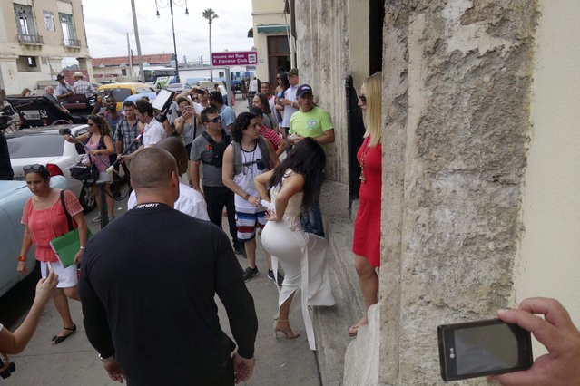 American reality-show star Kim Kardashian West, center in white, enters the Havana Club Rum Museum in Havana, Cuba, Wednesday, May 4, 2016. (Photo by Desmond Boylan/AP Photo)