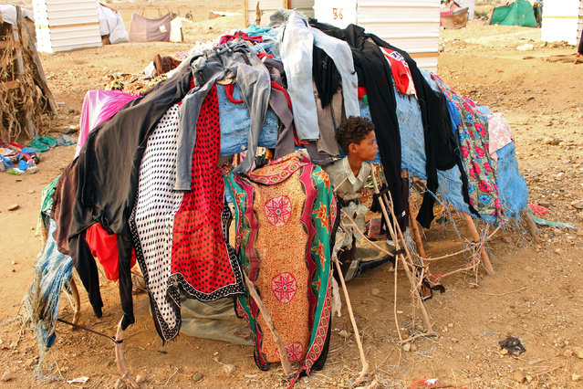 A displaced Yemeni child who fled the fightings is pictured at a makeshift camp in the district of Abs, in Yemen's northwestern Hajjah province on June 10, 2019. Saudi air defence forces on June 10 intercepted two drones launched by Huthi rebels from neighbouring Yemen, state media reported, as the Iran-aligned militia steps up attacks on the kingdom. The drones targeted Khamis Mushait in the kingdom's south and caused no damage or casualties, the Saudi-led coalition fighting in Yemen said in a brief statement released early Tuesday by the official Saudi Press Agency (SPA). (Photo by Essa Ahmed/AFP Photo)