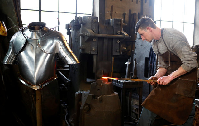 Blacksmith Johann Schmidberger works on an suit of armour for the Vatican's Swiss Guards at his workshop in Molln, Austria, March 29, 2017. (Photo by Leonhard Foeger/Reuters)