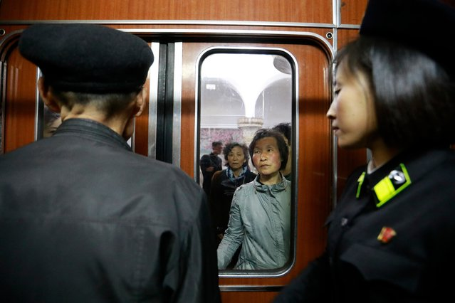 "North Korean commuters are seen through a door window waiting to board a train in a subway train station in Pyongyang, North Korea, 14 April 2017. North Koreans are preparing to celebrate the ""Day of the Sun"" festival, commemorating the 105th birthday anniversary of former supreme leader Kim Il-sung on 15 April, as tension over nuclear issues rise in the region. (Photo by How Hwee Young/EPA)"