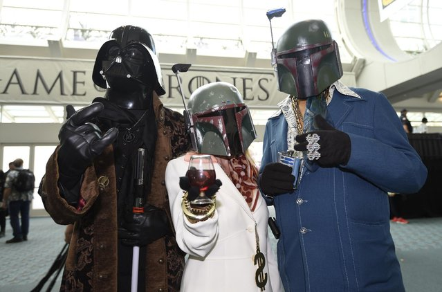 "Fans in personalized ""Star Wars"" costumes pose on the first day of the 2015 Comic-Con International held at the San Diego Convention Center Thursday, July 9, 2015 in San Diego. (Photo by Denis Poroy/Invision/AP Photo)"