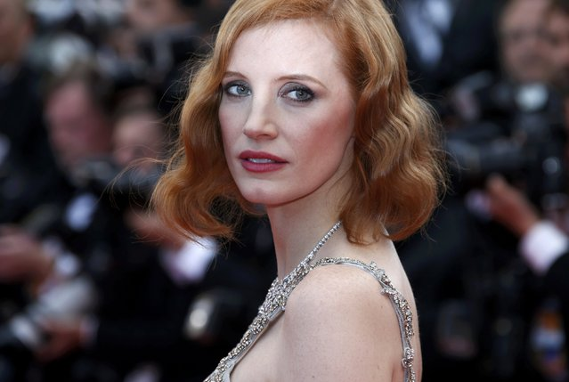 """Actress Jessica Chastain poses on the red carpet as she arrives for the screening of the film """"Money Monster"""" out of competition during the 69th Cannes Film Festival in Cannes, France, May 12, 2016. (Photo by Eric Gaillard/Reuters)"""
