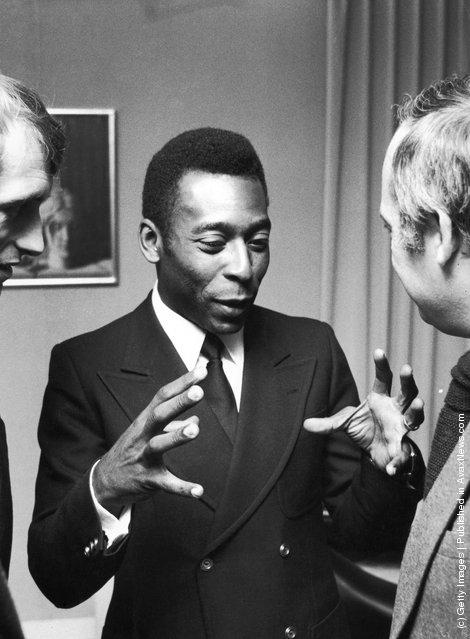 Brazilian footballer Pele talking to Belgian minister of culture H.F Van Aal, during a reception in Brussels, 26th March 1975