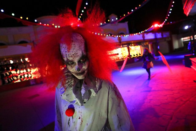 A participant wearing a costume and make-up attends a Halloween parade at Walibi park in Wavre, Belgium, October 25, 2019. (Photo by Yves Herman/Reuters)