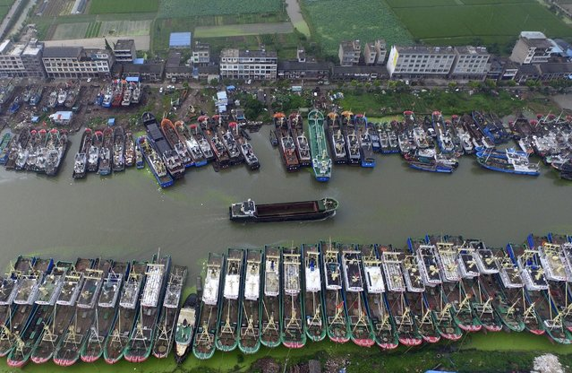 An aerial view shows boats being anchored in a bay as Typhoon Chan-Hom approaches Taizhou, Zhejiang province, China, July 9, 2015. Chinese authorities have suspended train services, closed schools and bought trawlers back to port before two typhoons in the south and east of the country make landfall later this week, state media said. (Photo by Reuters/Stringer)