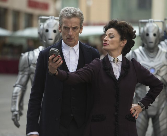 """This photo provided by BBC/BBC Worldwide shows, Peter Capaldi, left, as The Doctor, Michelle Gomez, as Missy, and Cybermen, in """"Doctor Who"""", season 8. (Photo by Adrian Rogers/BBC/BBC Worldwide via AP Photo)"""