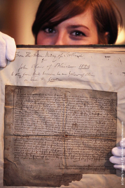 Charlotte Roirdan from Lyon & Turnbull views a letter written by Mary Queen of Scots