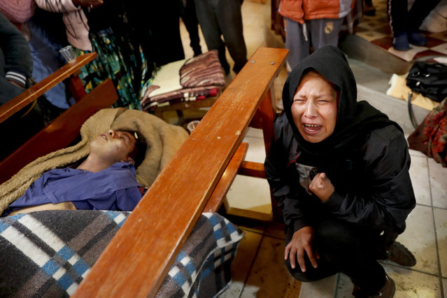 Gloria Quispe mourns next to the body of her brother Antonio, killed during clashes between security forces and supporters of former President Evo Morales, at the San Francisco de Asis church in El Alto, outskirts of La Paz, Bolivia, Wednesday, November 20, 2019. (Photo by Natacha Pisarenko/AP Photo)