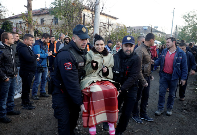 Emergency workers carry a woman in Thumane, after an earthquake shook Albania, November 26, 2019. (Photo by Florian Goga/Reuters)