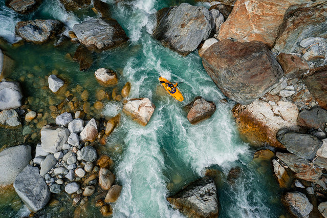 """""""Kayaking"""". Aerial view of a kayaker doing kayak in the Reuss river in Switzerland. Photo location: Reuss River, Switzerland. (Photo and caption by Chris Schmid/National Geographic Photo Contest)"""