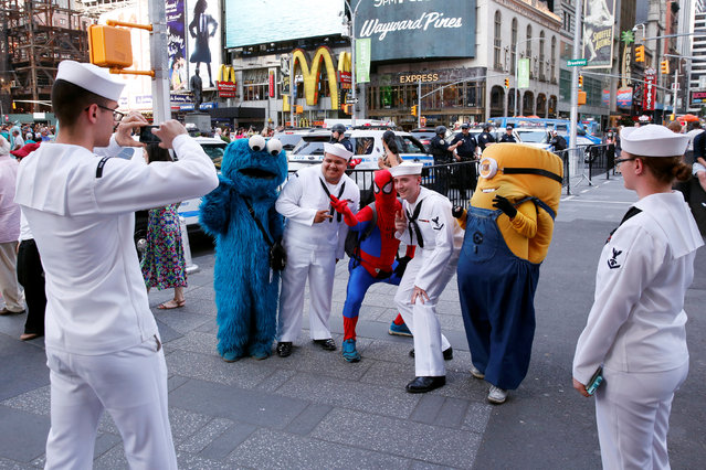 U.S. Navy sailors stop to take photographs as they walk through Times Square during Fleet Week in New York, U.S., May 25, 2016. (Photo by Lucas Jackson/Reuters)