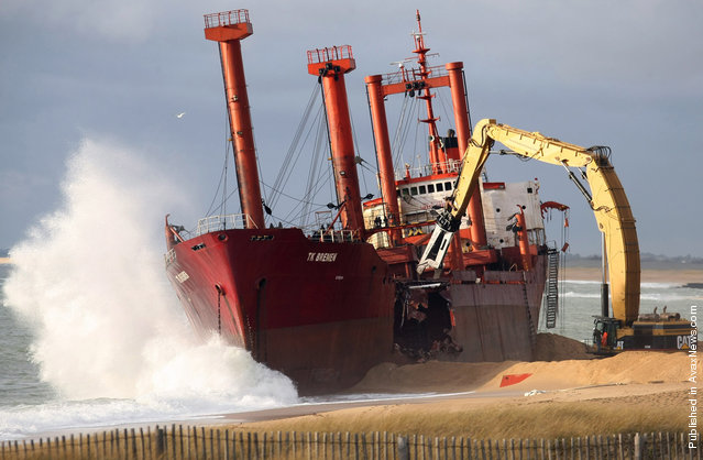The beached TK Bremen is broken apart at Erdeven, France, on January 7, 2012